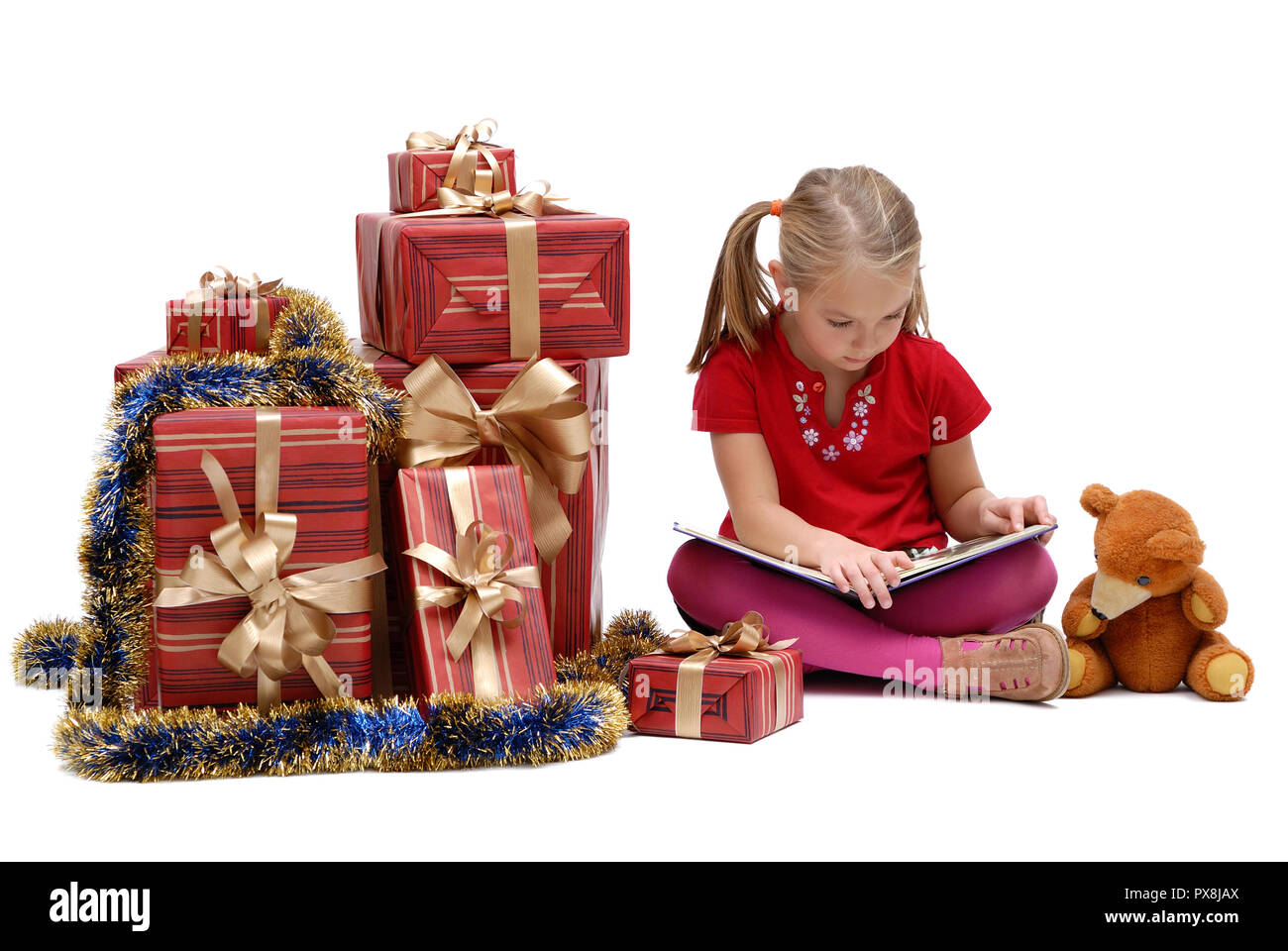 Cute little girl with Christmas gifts on a white background ...