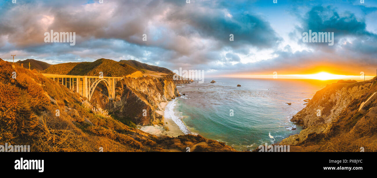 Scenic panoramic view of California Central Coast with historic Bixby Creek Bridge along world famous Highway 1 in beautiful golden evening light at s - Stock Image