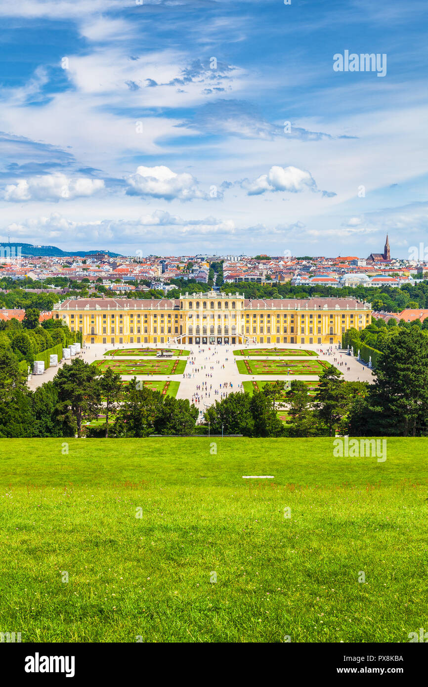 Classic view of famous Schonbrunn Palace with scenic Great Parterre garden on a beautiful sunny day with blue sky and clouds in summer, Vienna - Stock Image