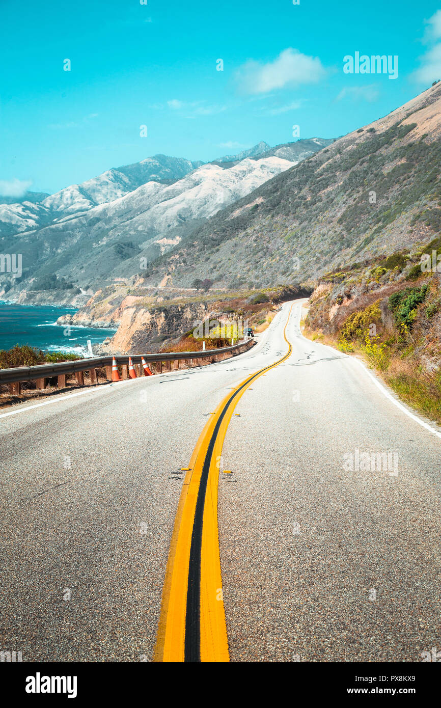Scenic view of world famous Highway 1 with the rugged coastline of Big Sur in beautiful golden evening light at sunset in summer, California Central C - Stock Image