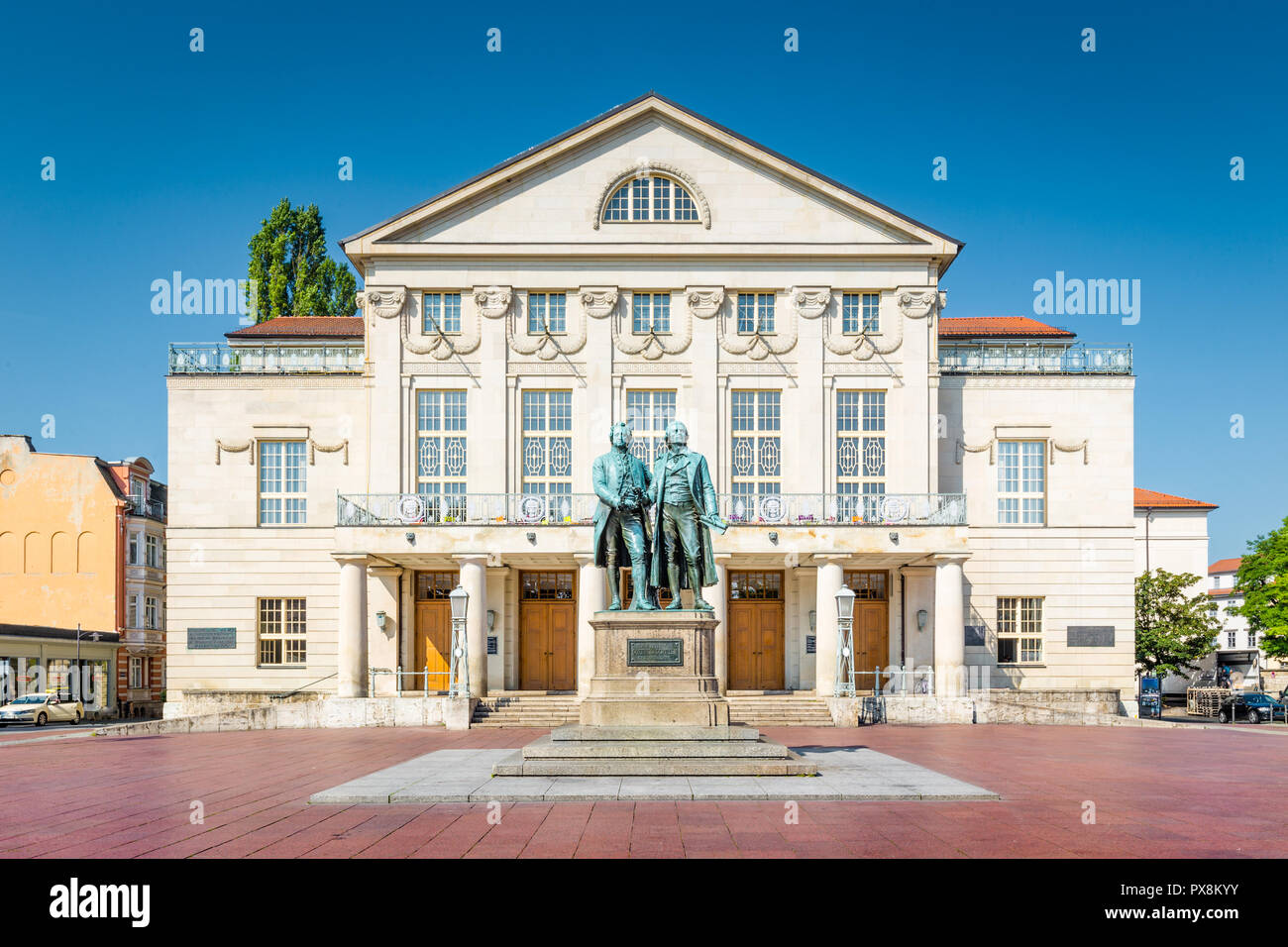 Classic view of famous Deutsches Nationaltheater with Goethe-Schiller monument on a beautiful sunny day with blue sky in Weimar, Thuringia, Germany - Stock Image