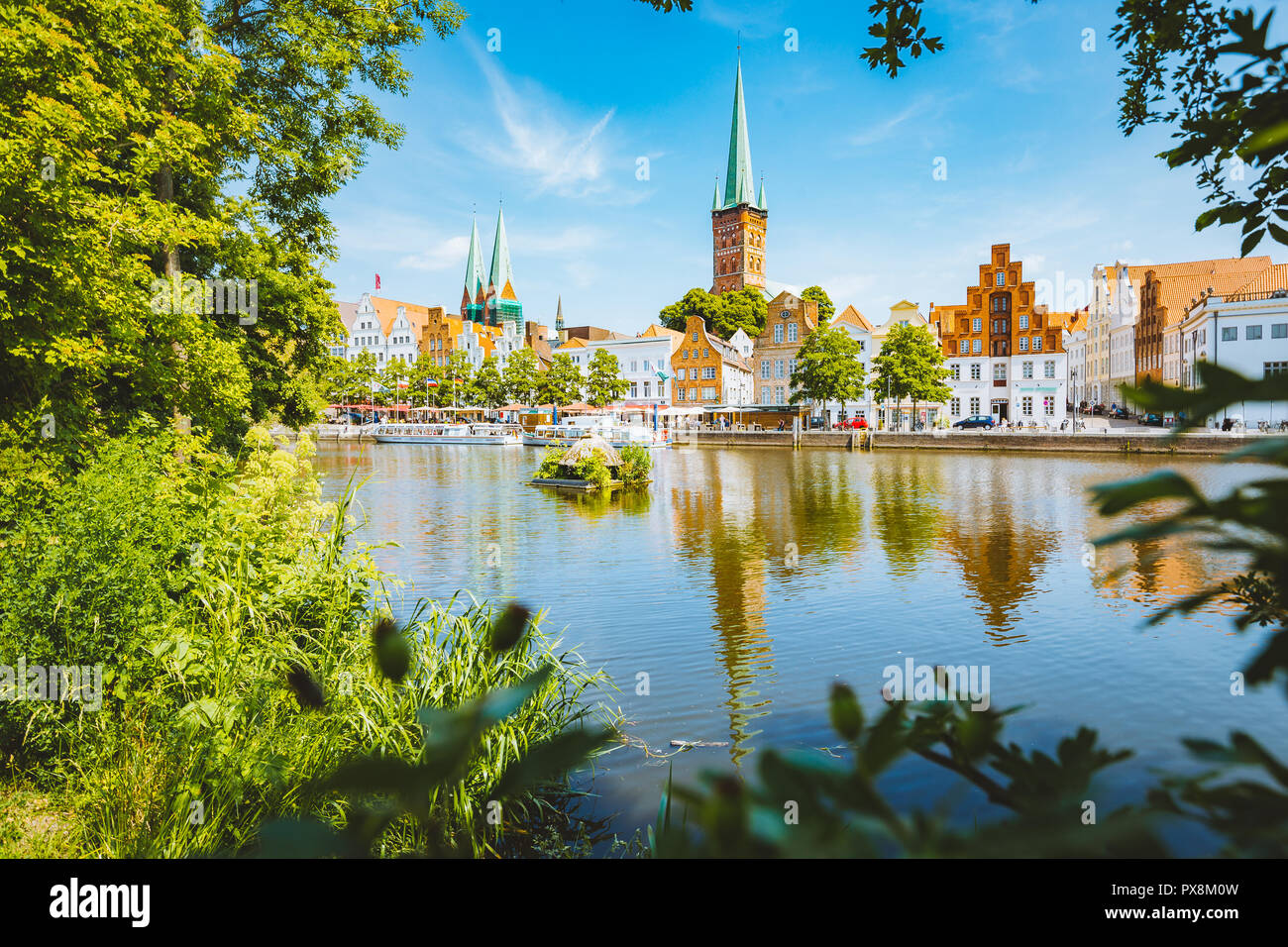 Classic panorama view of the historic city of Luebeck with famous Trave river in summer, Schleswig-Holstein, Germany - Stock Image