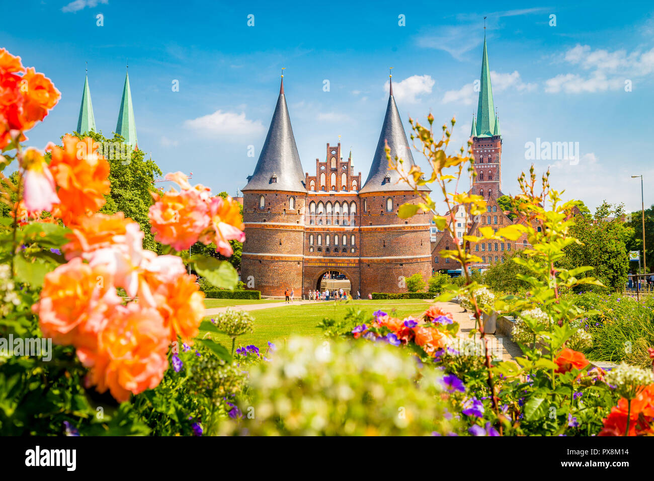 Classic postcard view of the historic town of Lübeck with famous Holstentor gate in summer, Schleswig-Holstein, northern Germany - Stock Image