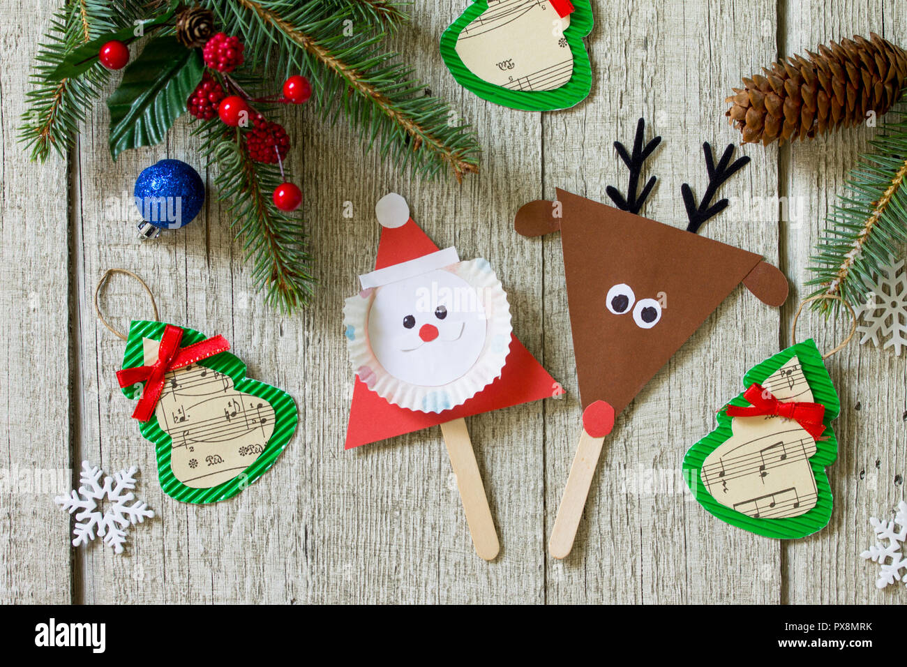 Christmas merry gift on wooden table - Santa, Reindeer and toys star ...