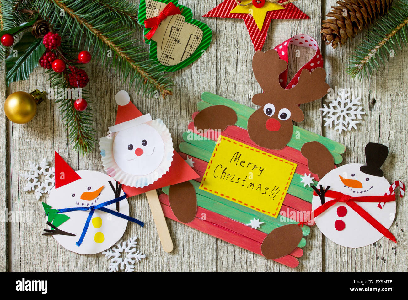 Christmas merry gift on wooden table - Santa, Reindeer and snowman ...