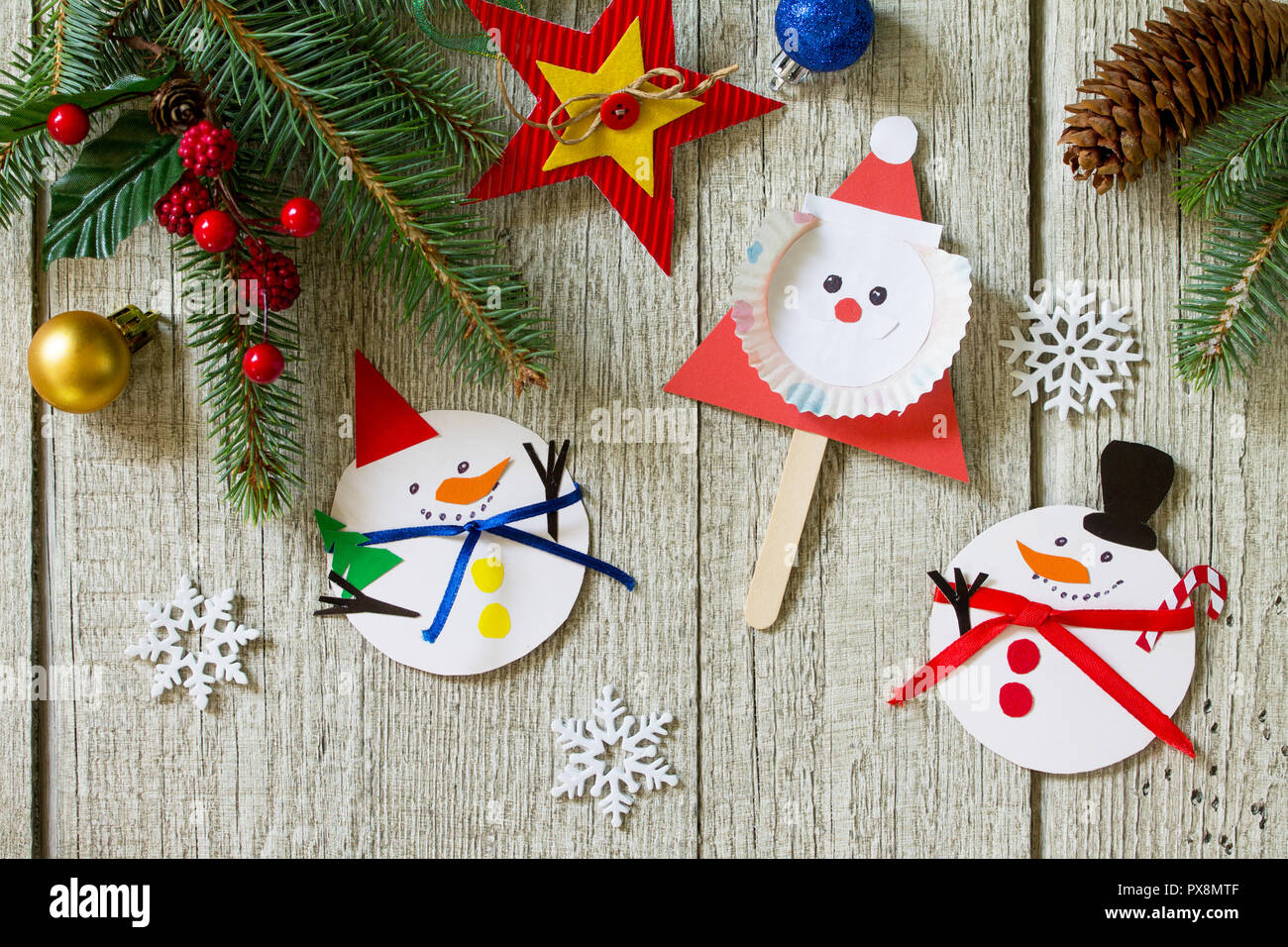 Christmas merry gift on wooden table - Santa and snowman toys ...