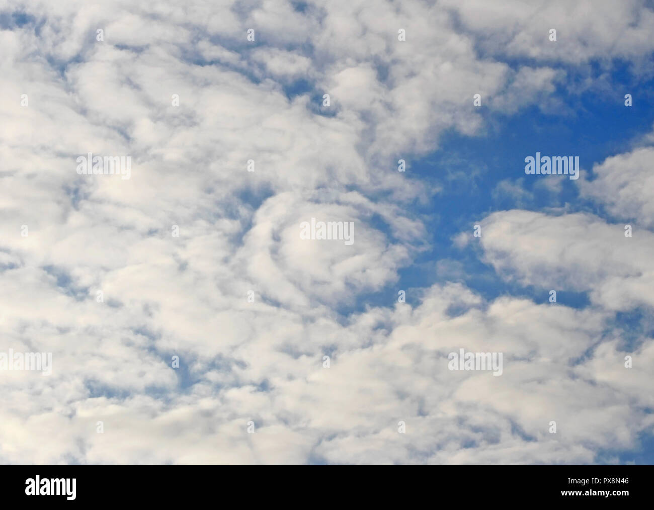 Blanket of Stratus Clouds forming against a blue summer sky Stock Photo
