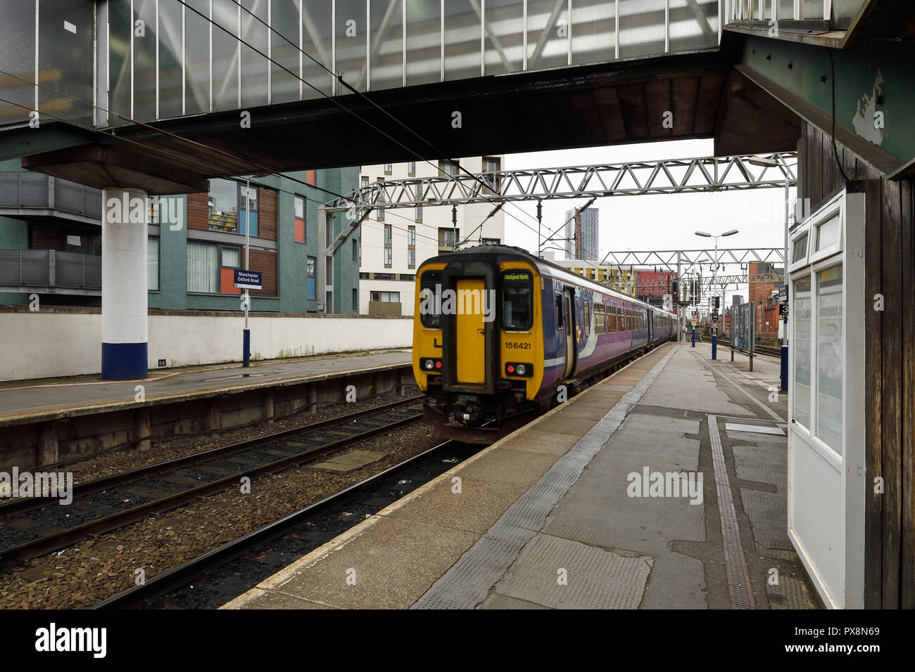 A train leaving Manchester Oxford Road station in Manchester city centre UK - Stock Image
