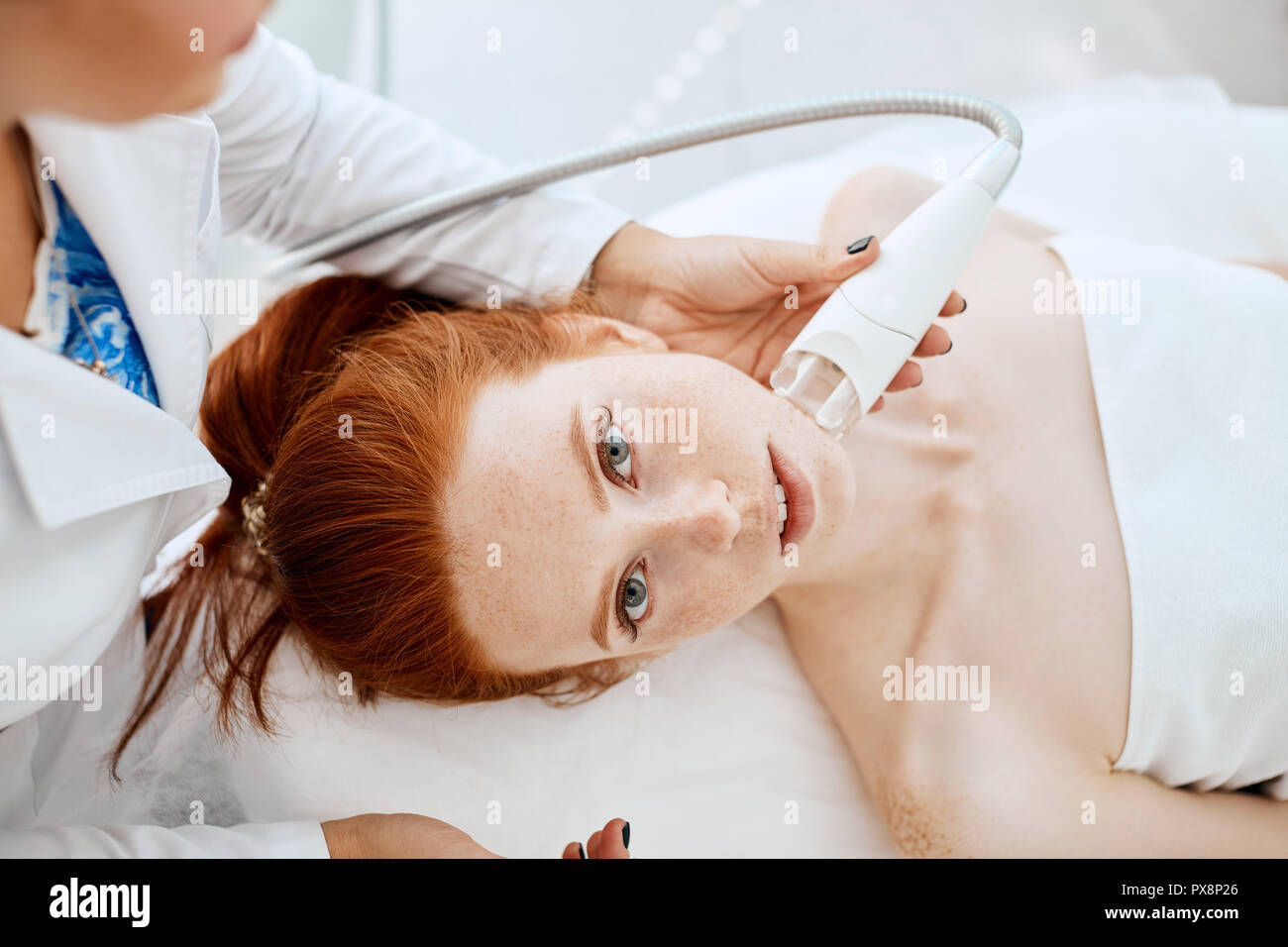 Woman getting rf-lifting in a beauty salon. Modern technologies in cosmetology. - Stock Image