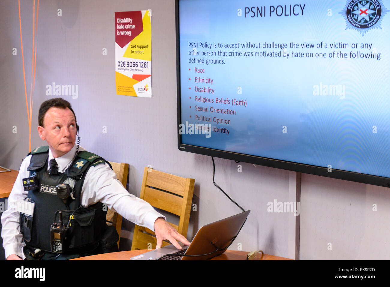 Belfast, Northern Ireland. 16/10/2016 - A police officer delivers a presentation on Hate crime awareness. - Stock Image