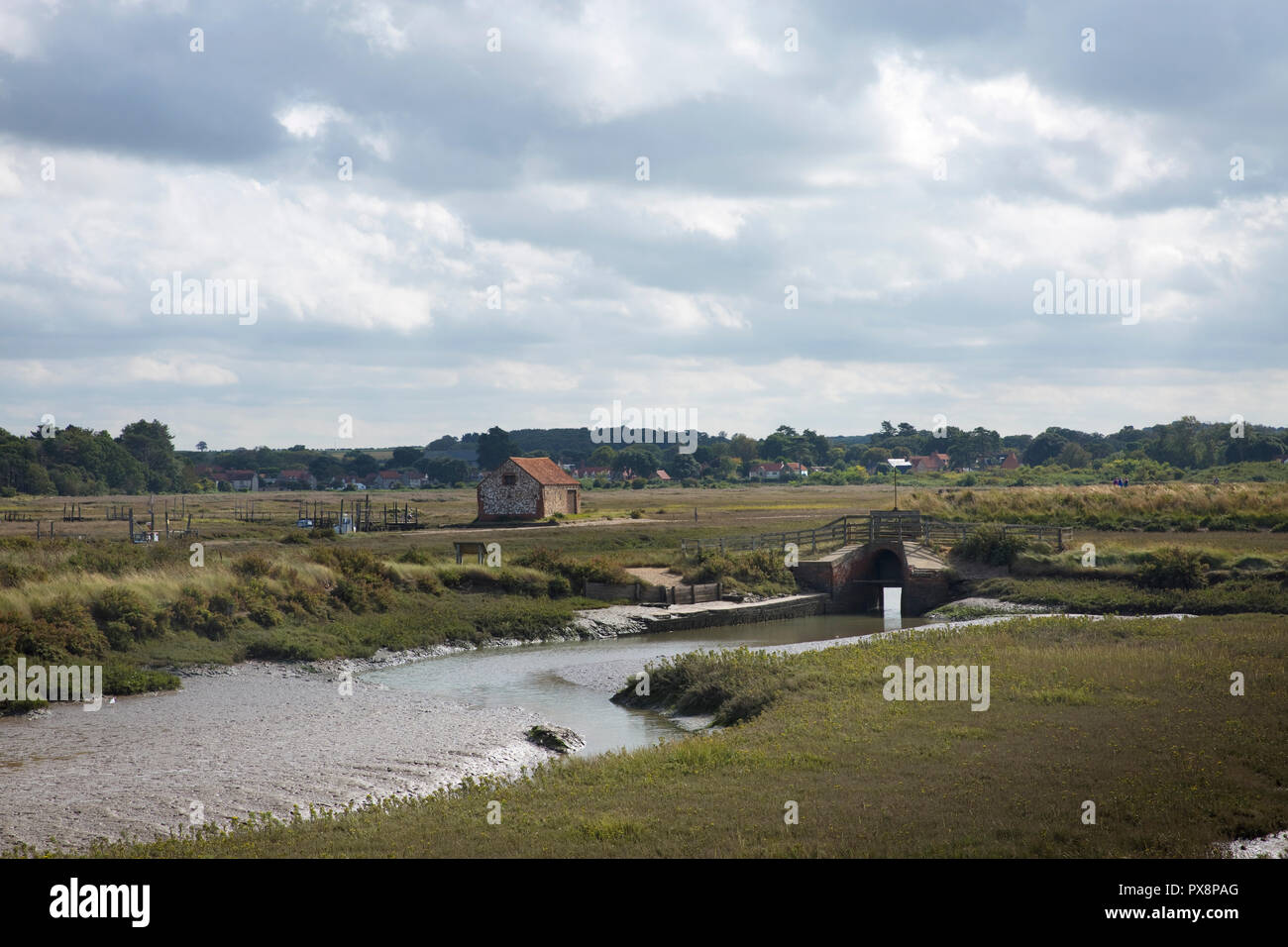 Old boat-house and estuary at Thornham Old Harbour, Thornham, Norfolk, England - Stock Image