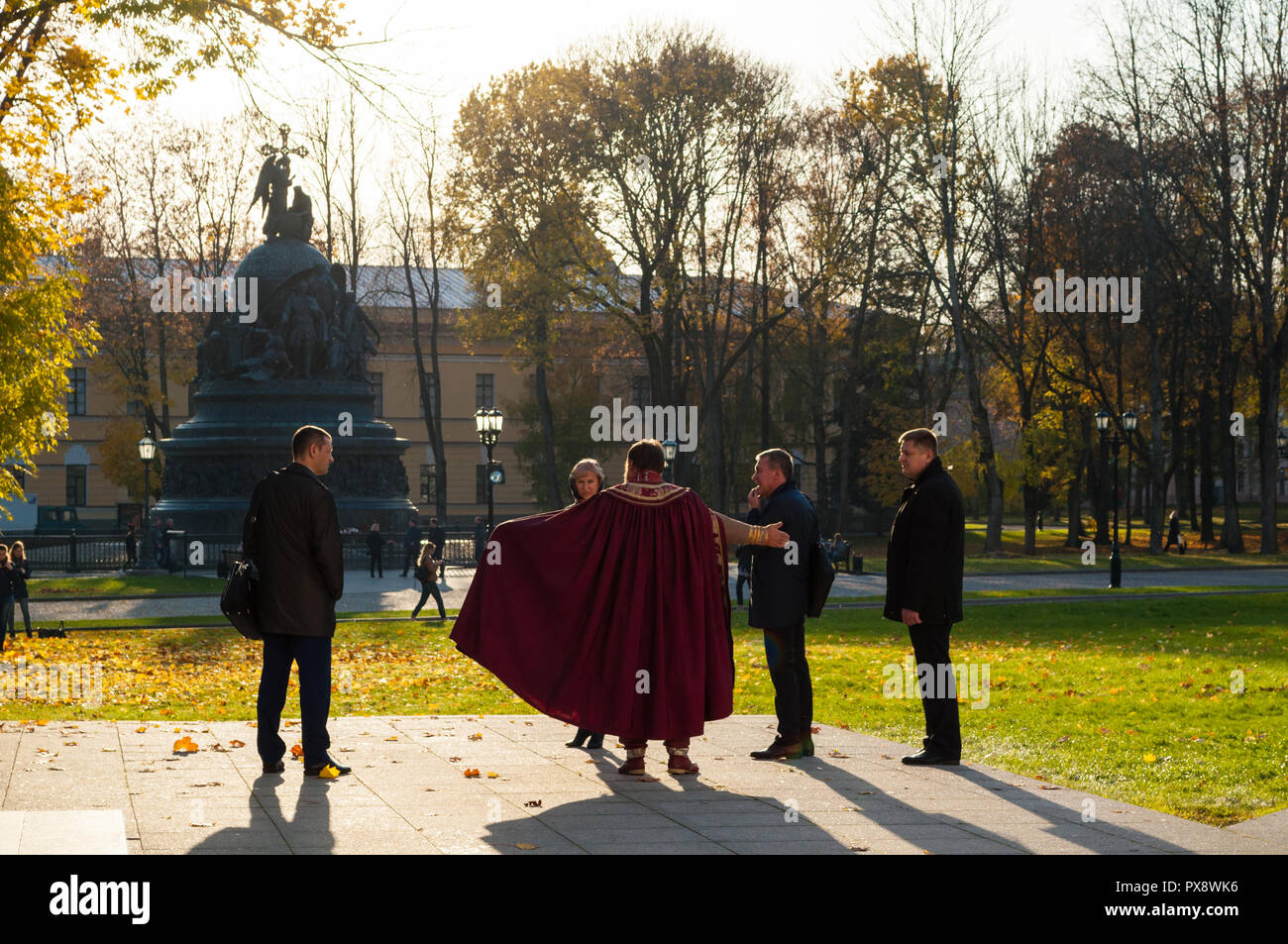 Veliky Novgorod, Russia - October 17, 2018. Tour guide actor and tourists at the excursion at the territory of Novgorod Kremlin, Veliky Novgorod - Stock Image