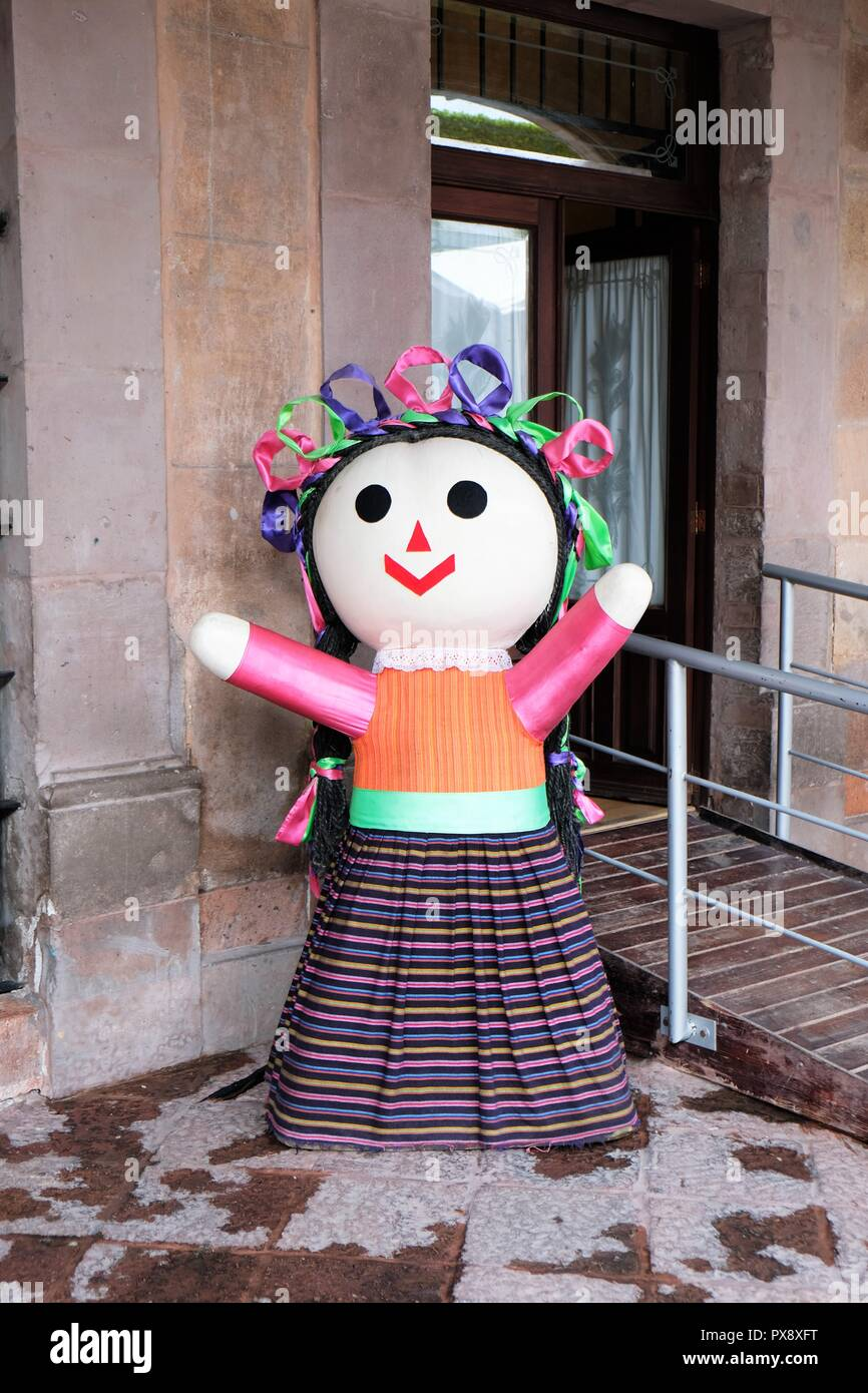 A human size 'Maria doll' made of cloth and adorned with skirt and ribbons, originally made by the Mazahua natives in Michoacan, Mexico. - Stock Image