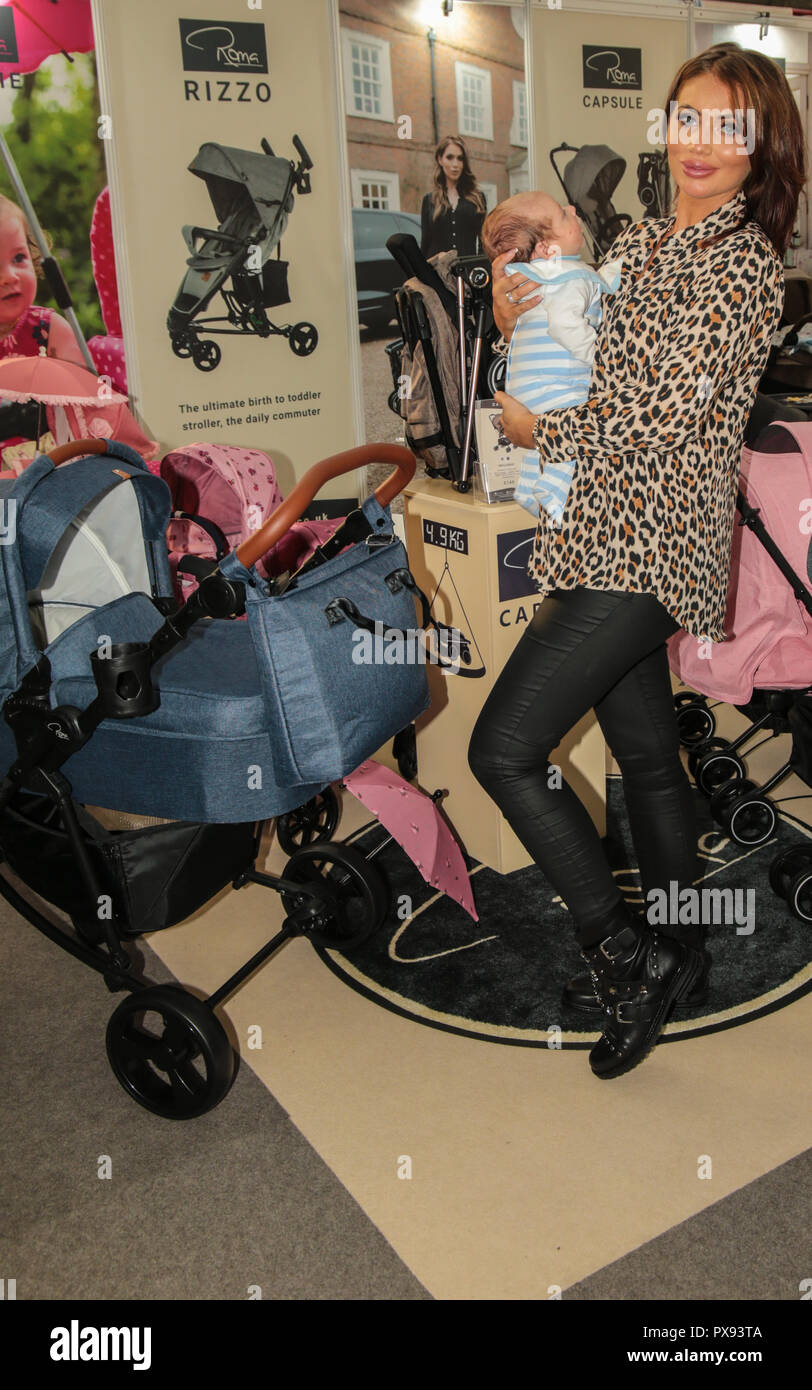 London UK 20 October 2018 Amy Childs television personality, model, businesswoman and fashion designer ,voted celebrity mother of the year at the stand of Rome  with her baby Richie at the baby show held in London Olympia 2018@Paul Quezada-Neiman/Alamy Live News - Stock Image