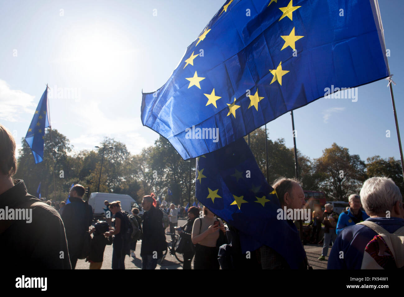 London, UK. 20th Oct, 2018. Protesters waving EU flags at the anti-Brexit People's Vote March in central London, 20 October 2018 Credit: Hallberg Photo/Alamy Live News - Stock Image