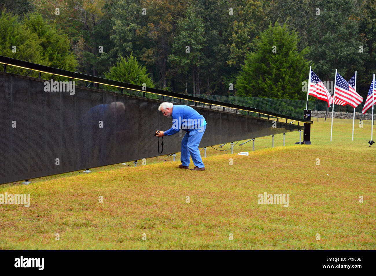 Wake Forest, North Carolina, United States. 20th Oct, 2018: The Wall That Heals, a mobile replica of the Vietnam Memorial in Washington DC, visits Wake Forest on it's cross country journey honoring veterans and to provide friends and families a way to remember servicemen who died in the conflict. Credit: D Guest Smith/Alamy Live News - Stock Image