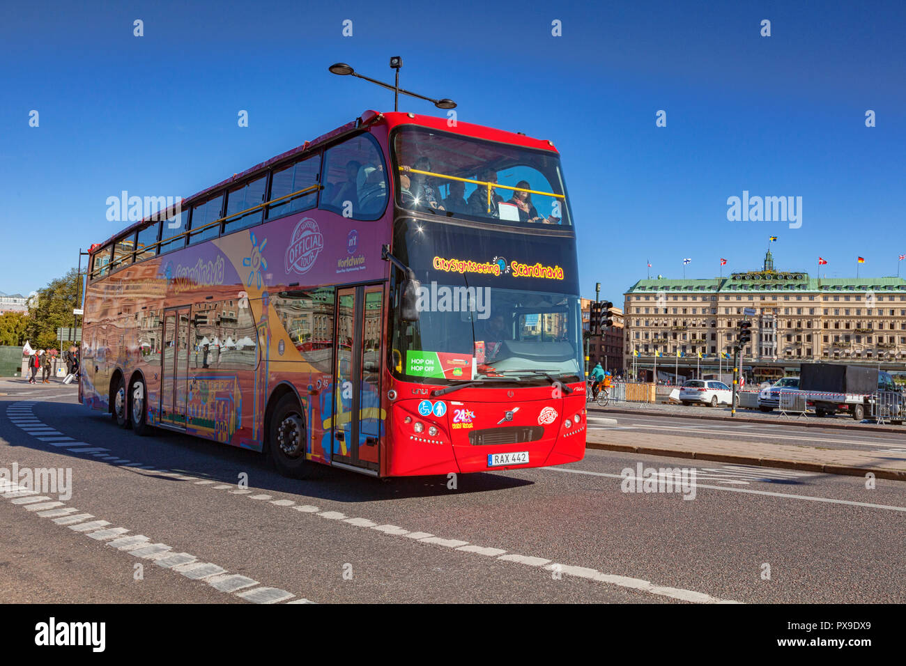 16 September 2018: Stockholm, Sweden - Red double decker tour bus in central city, with clear blue sky. - Stock Image