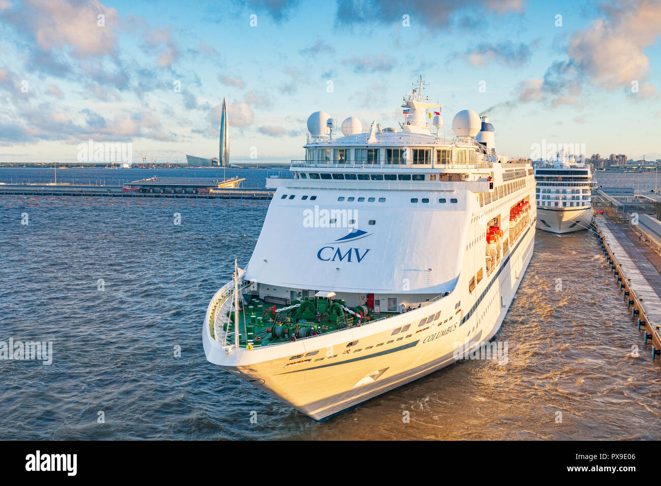 18 September 2018: St Petersburg, Russia - Cruise ships at the Cruise Terminal, with the tallest building in Europe in the background, the Gazprom Tow - Stock Image