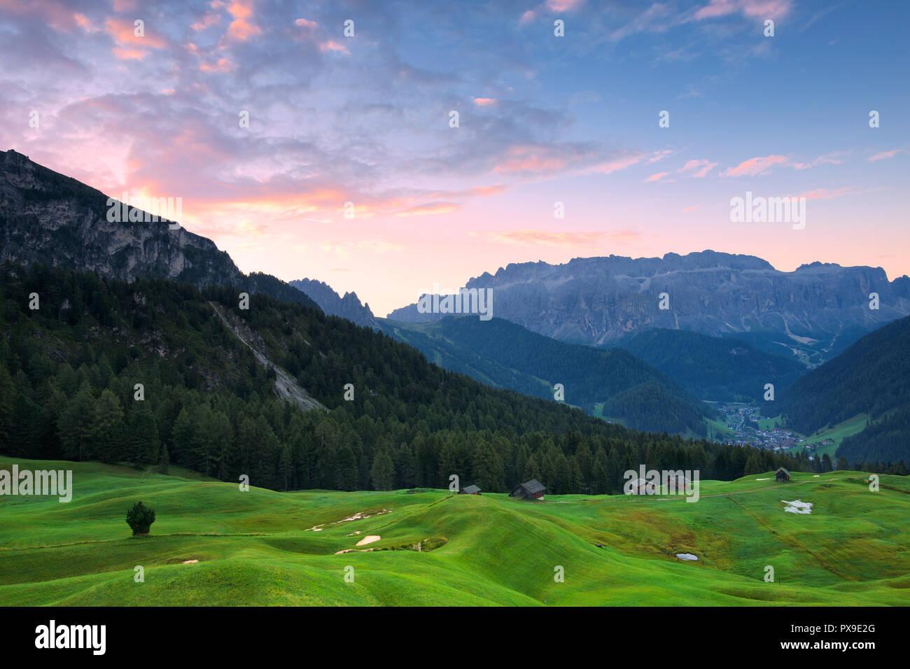 Sunrise in the pasture of Daunei. Selva Val Gardena, Gardena Valley, South Tyrol, Dolomites, Italy, Europe. Stock Photo