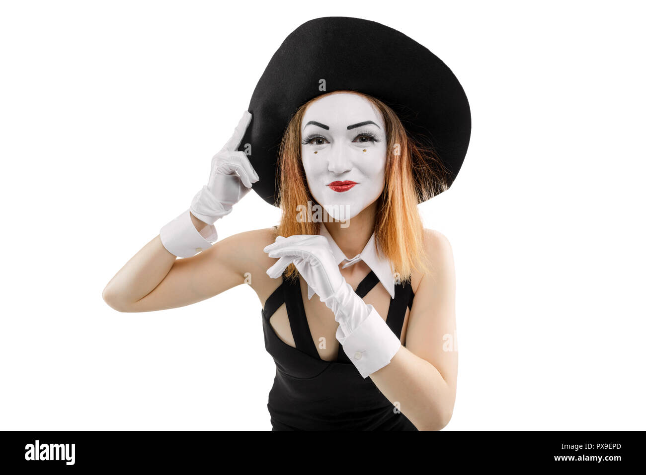 Female mime posing before mirror - Stock Image