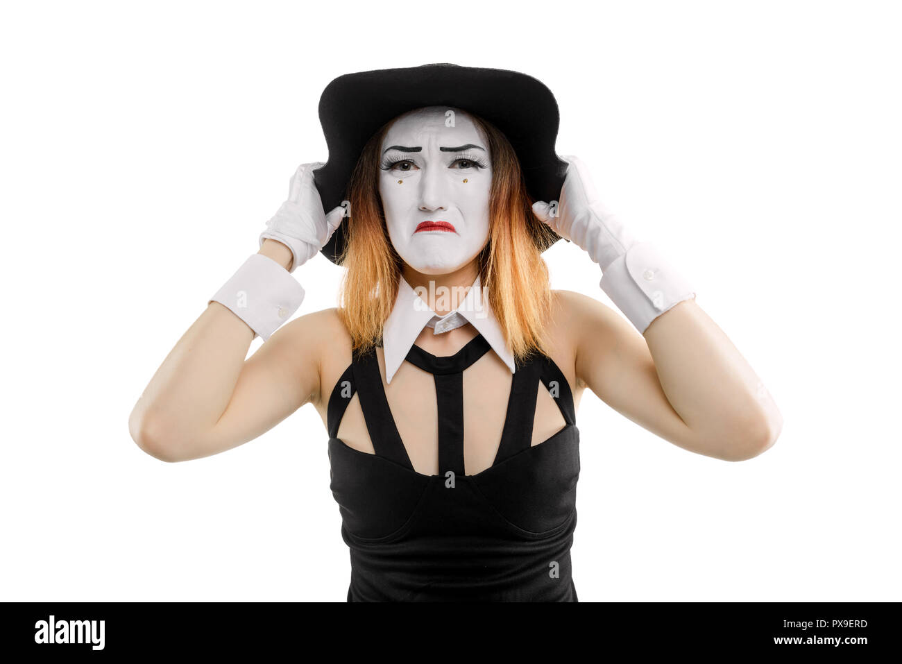 Sad female mime on white - Stock Image