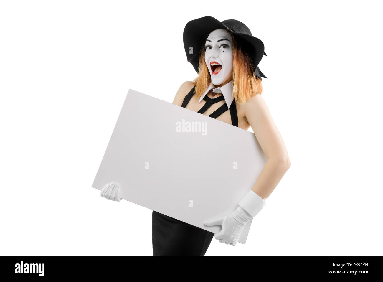Happy female mime holding board - Stock Image