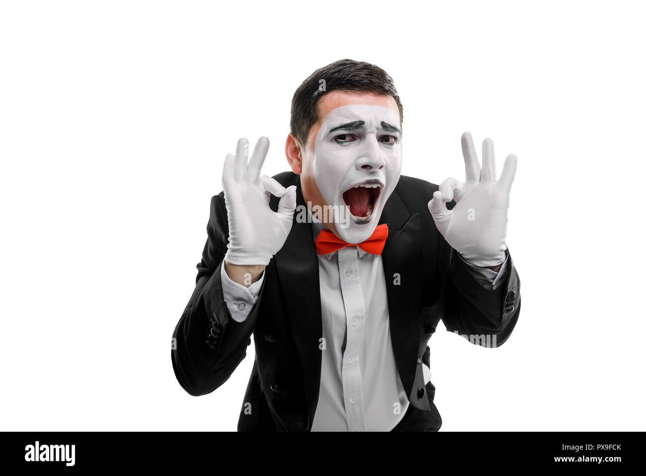Cheerful male mime showing ok - Stock Image