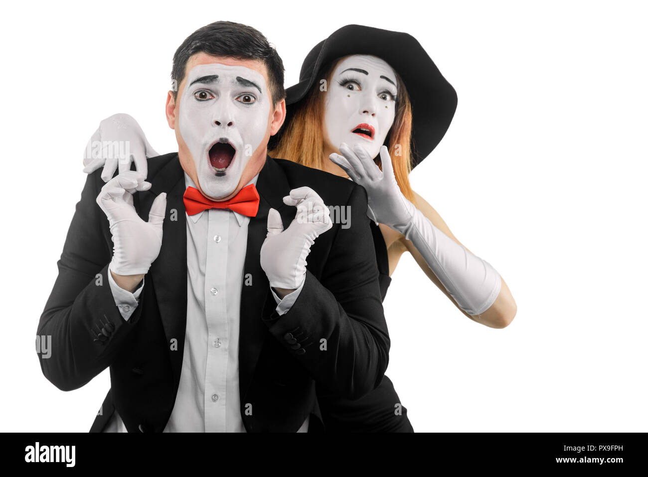 Two frightened mime actors - Stock Image