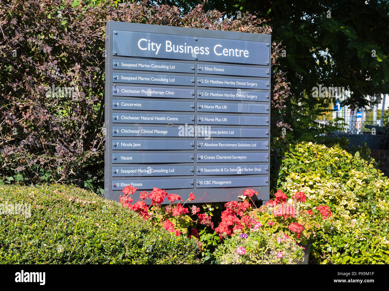 City Business Centre sign showing a list of businesses in the centre, in Chichester, West Sussex, England, UK. - Stock Image