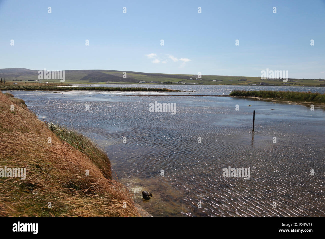 The Loch of Stenness, Orkney, looking towards Hoy, seen from the Bridge of Brodgar - Stock Image