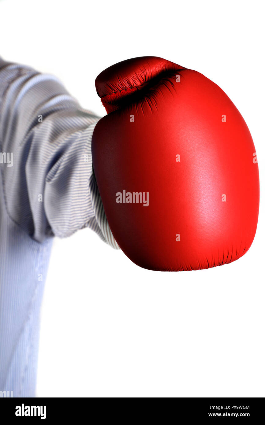 businessman arm wearing a box glove in the act of throwing a jab, business confrontation concept - Stock Image
