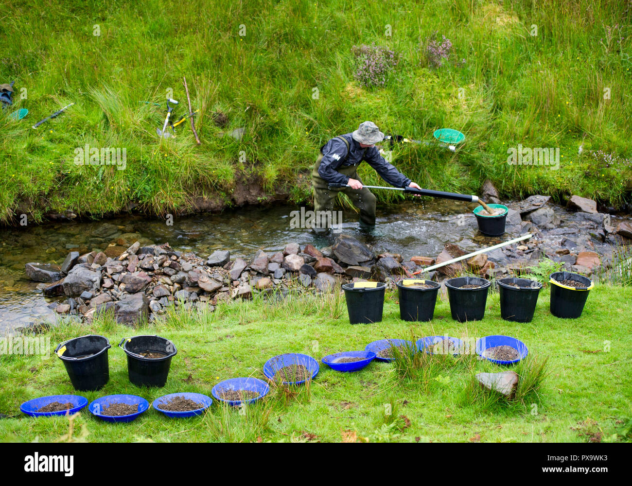 Gold panning course for visitors and tourists on the Mennock water near Wanlockhead, Scotland. - Stock Image