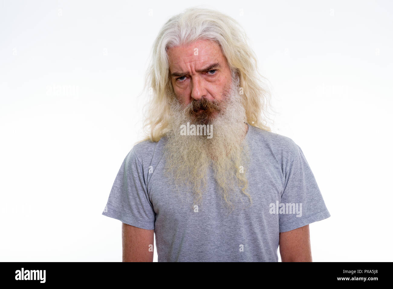 Studio shot of senior bearded man looking upset  - Stock Image