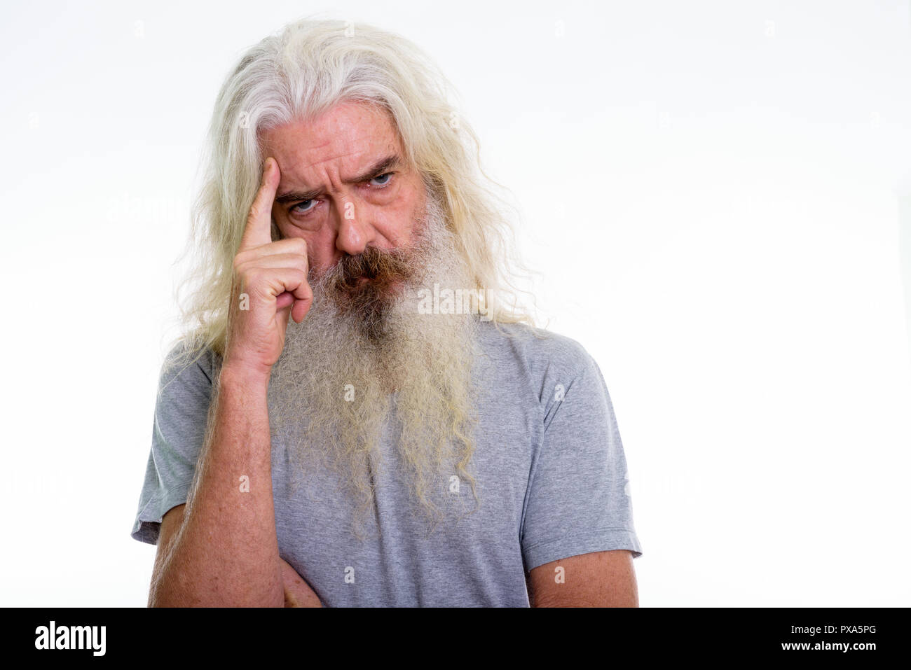 Close up of senior bearded man thinking with finger on head - Stock Image