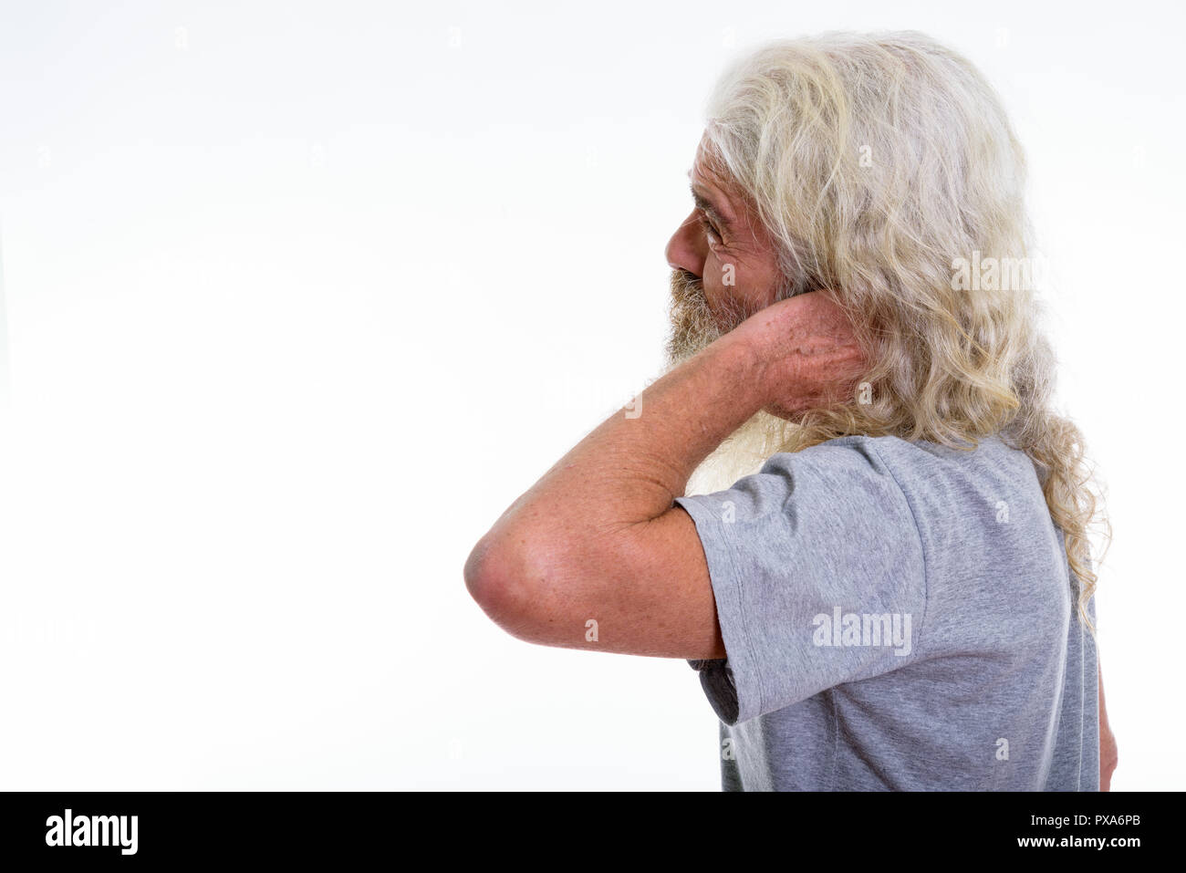 Profile view of stressed senior bearded man having pain in the n - Stock Image