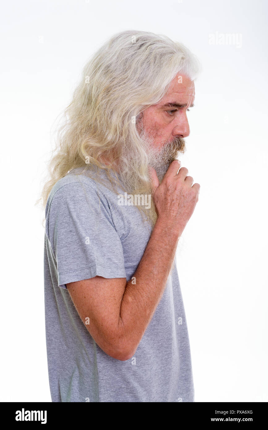 Profile view of senior bearded man thinking - Stock Image