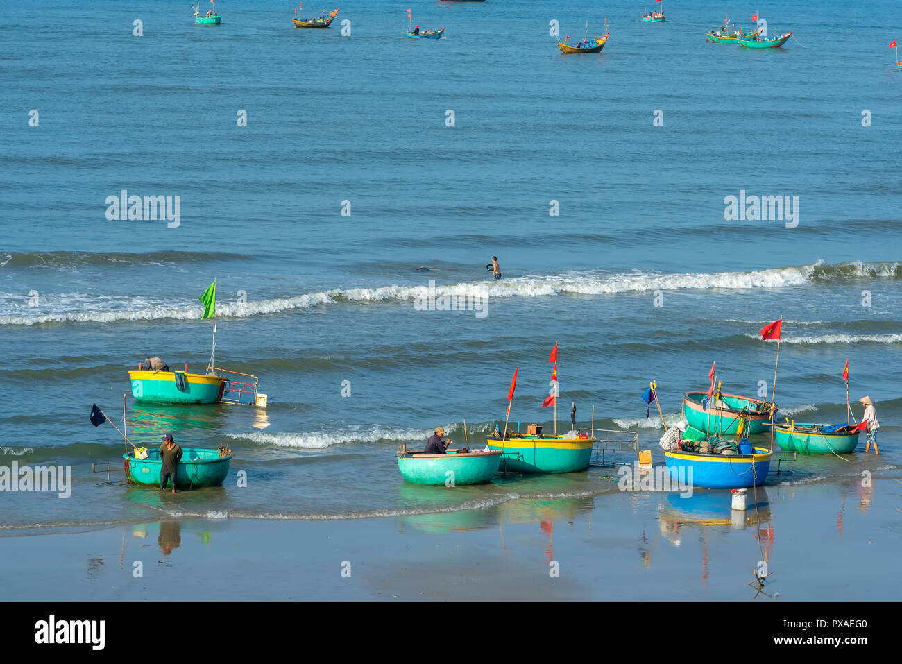 Pier fishing at Mui Ne beach in the morning when the fishermen prepare for a trip out to sea full of fish caught - Stock Image