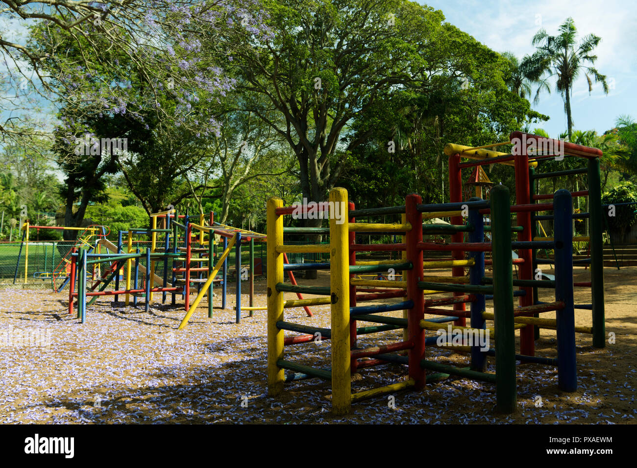 Colourful jungle gym equipment in children's playground at Mitchell Park botanical garden, Durban, South Africa - Stock Image