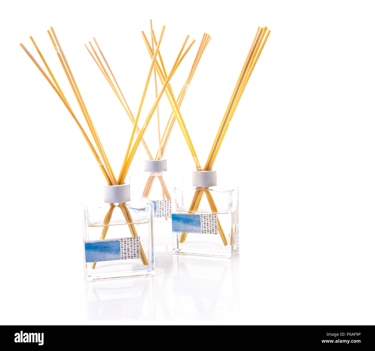 Three Reed Defusers on a white background - Stock Image