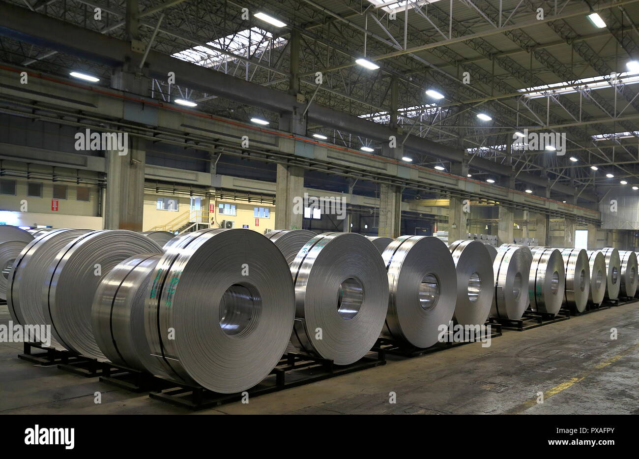 View of finished aluminum sheet rolls in a factory producing semi-finished products. - Stock Image