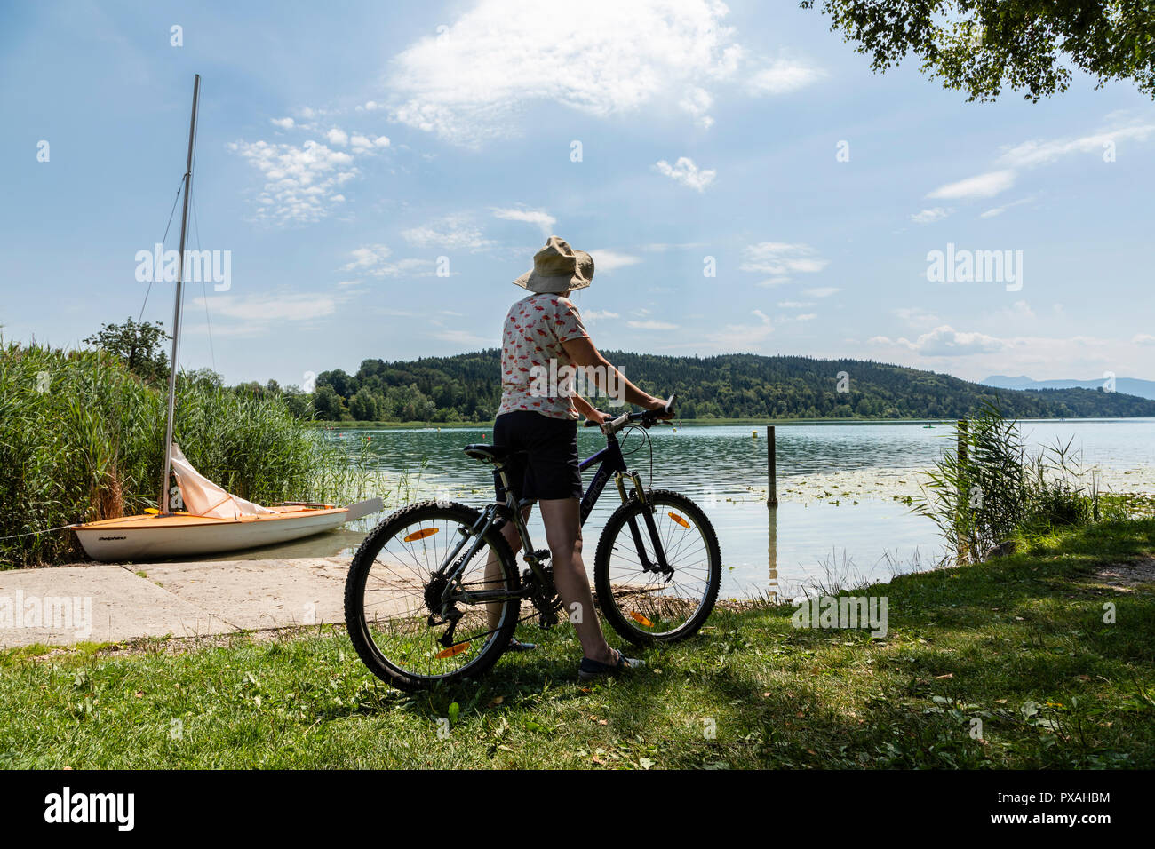Cyclist at Tachinger See, Bavaria, Germany - Stock Image