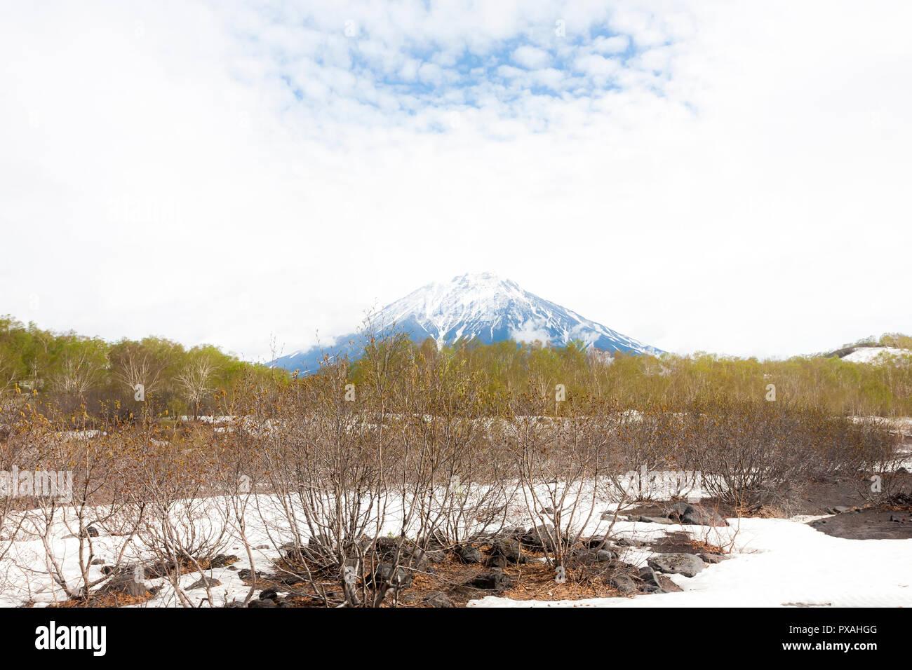 Koryaksky Volcano is an active stratovolcano of Kamchatka Peninsula, Russia. - Stock Image
