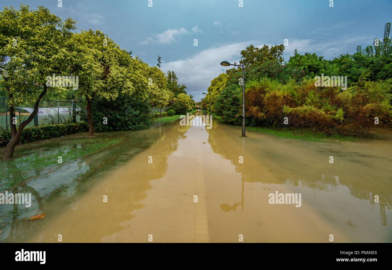 Flooded old Turia river bank after heavy rain - Stock Image