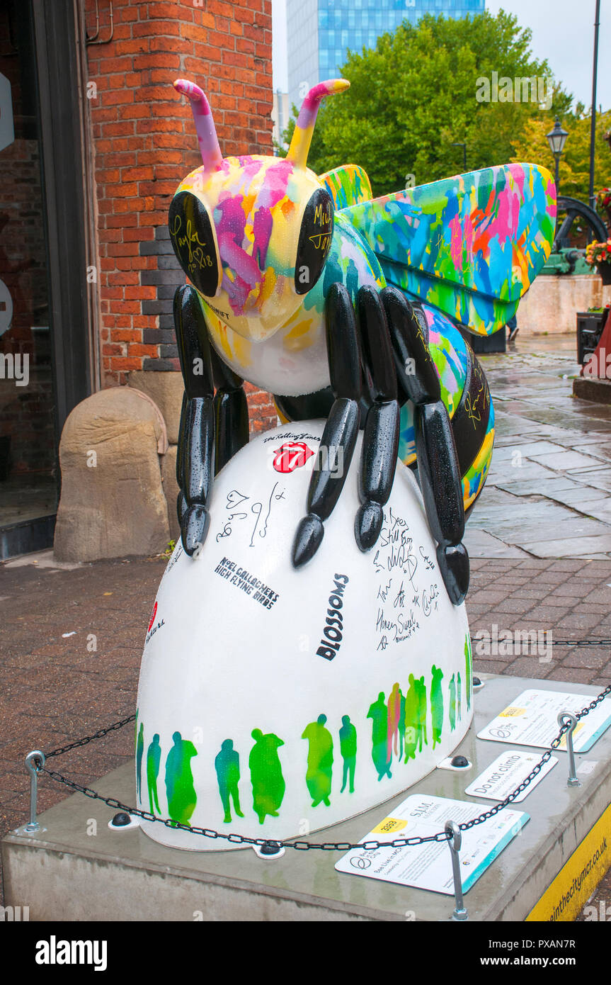 Bee Live in MCR, by Amy Coney.  One of the Bee in the City sculptures, Liverpool Road, Manchester, UK. - Stock Image