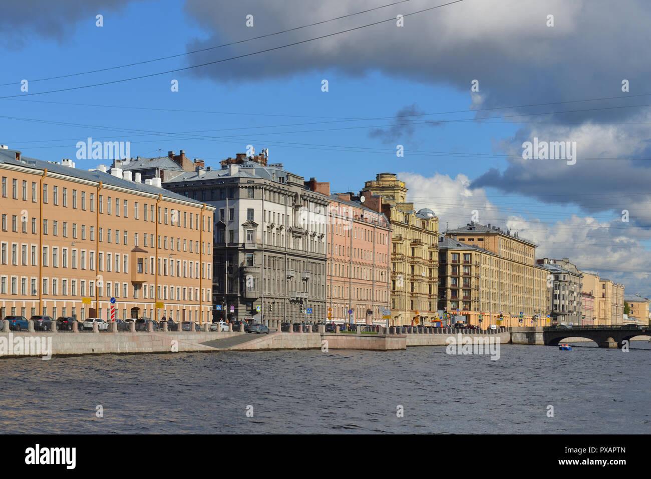 Embankment of Fontanka River, old former Profitable houses and Izmailovsky Bridge (1861) - Stock Image