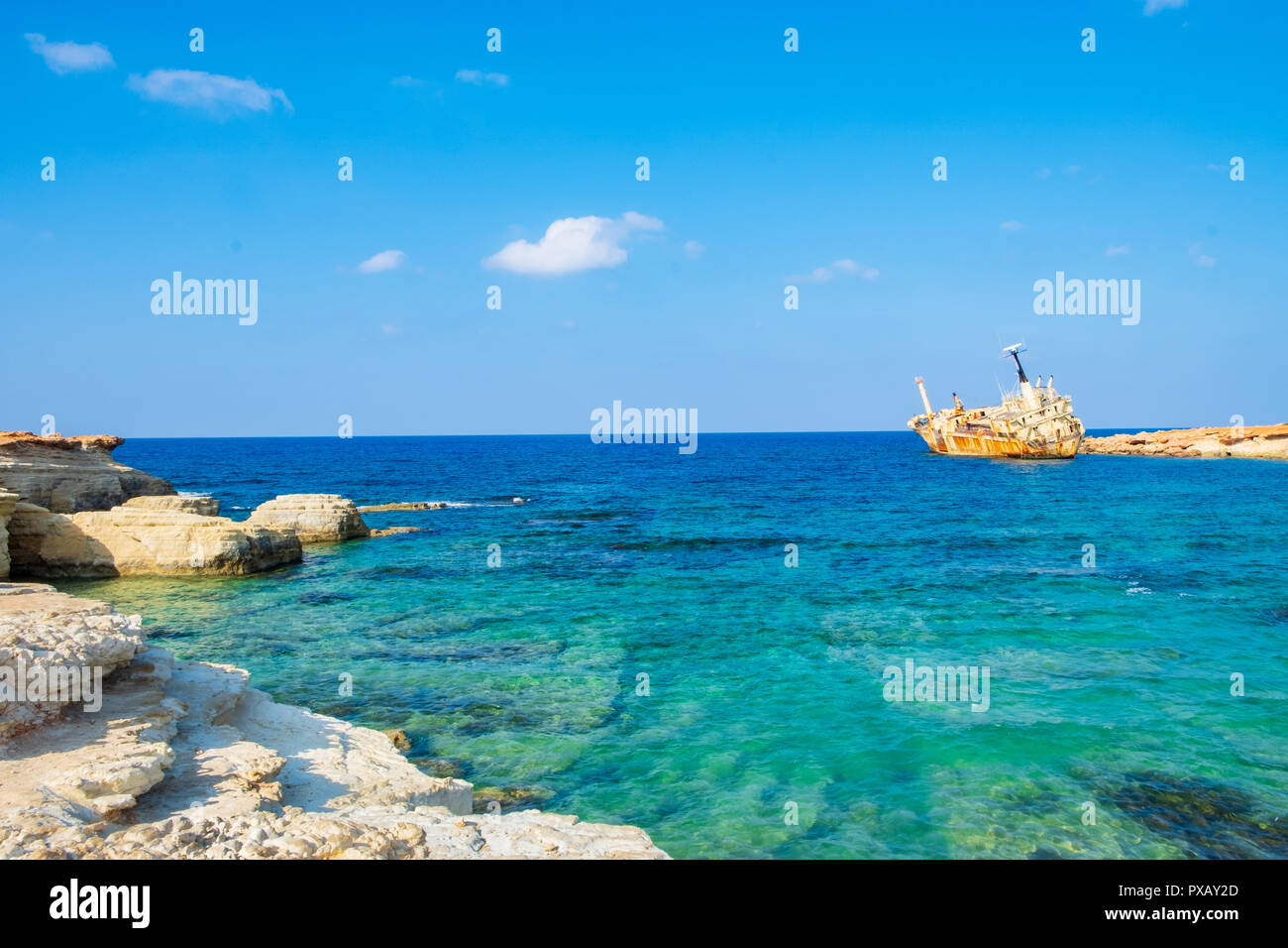 Abandoned rusty ship wreck EDRO III in Pegeia, Paphos, Cyprus. It is stranded on Peyia rocks at kantarkastoi sea caves, Coral Bay, Pafos, standing at  - Stock Image