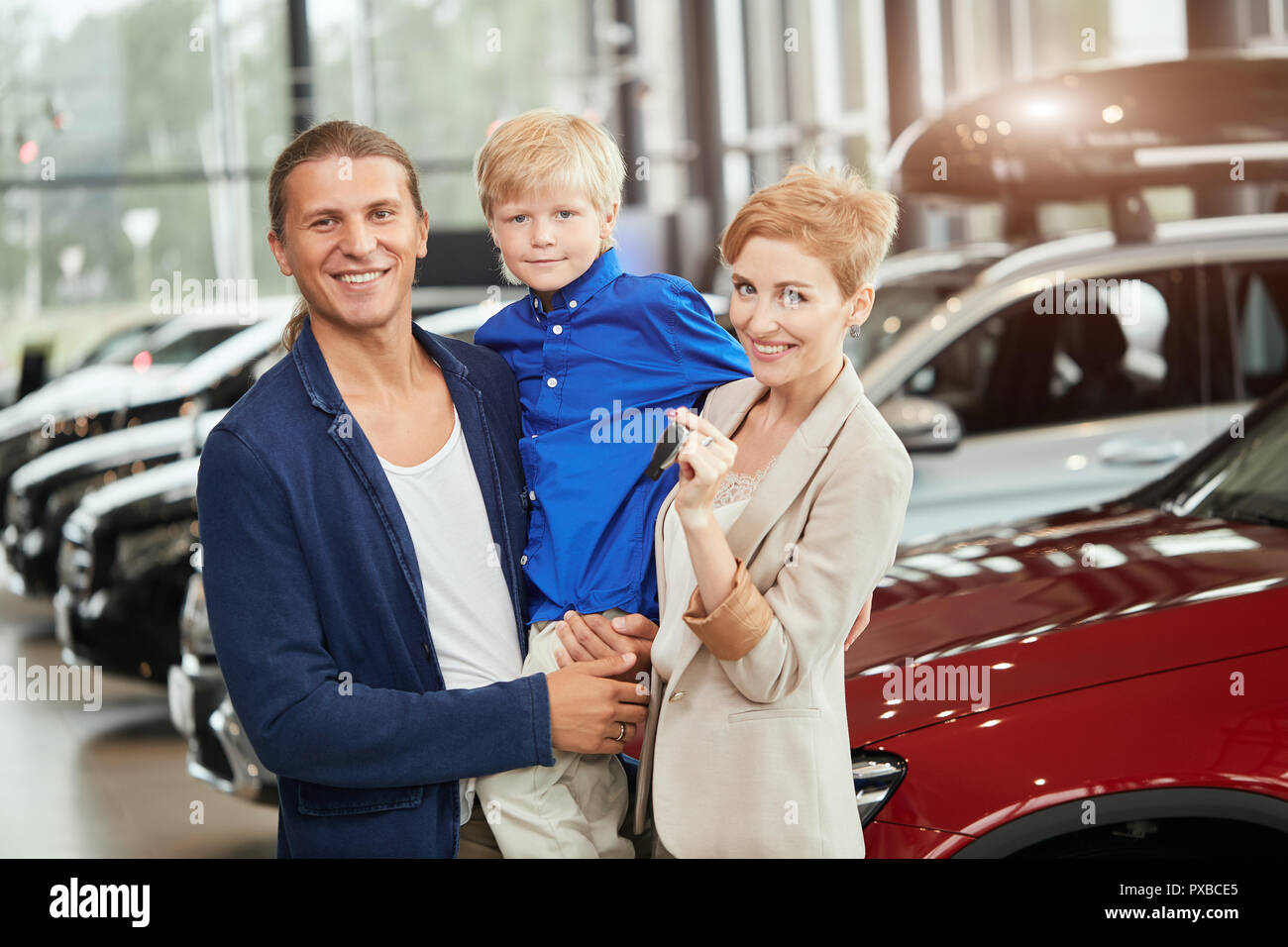 automobile sales centre young family with child boy in car sell