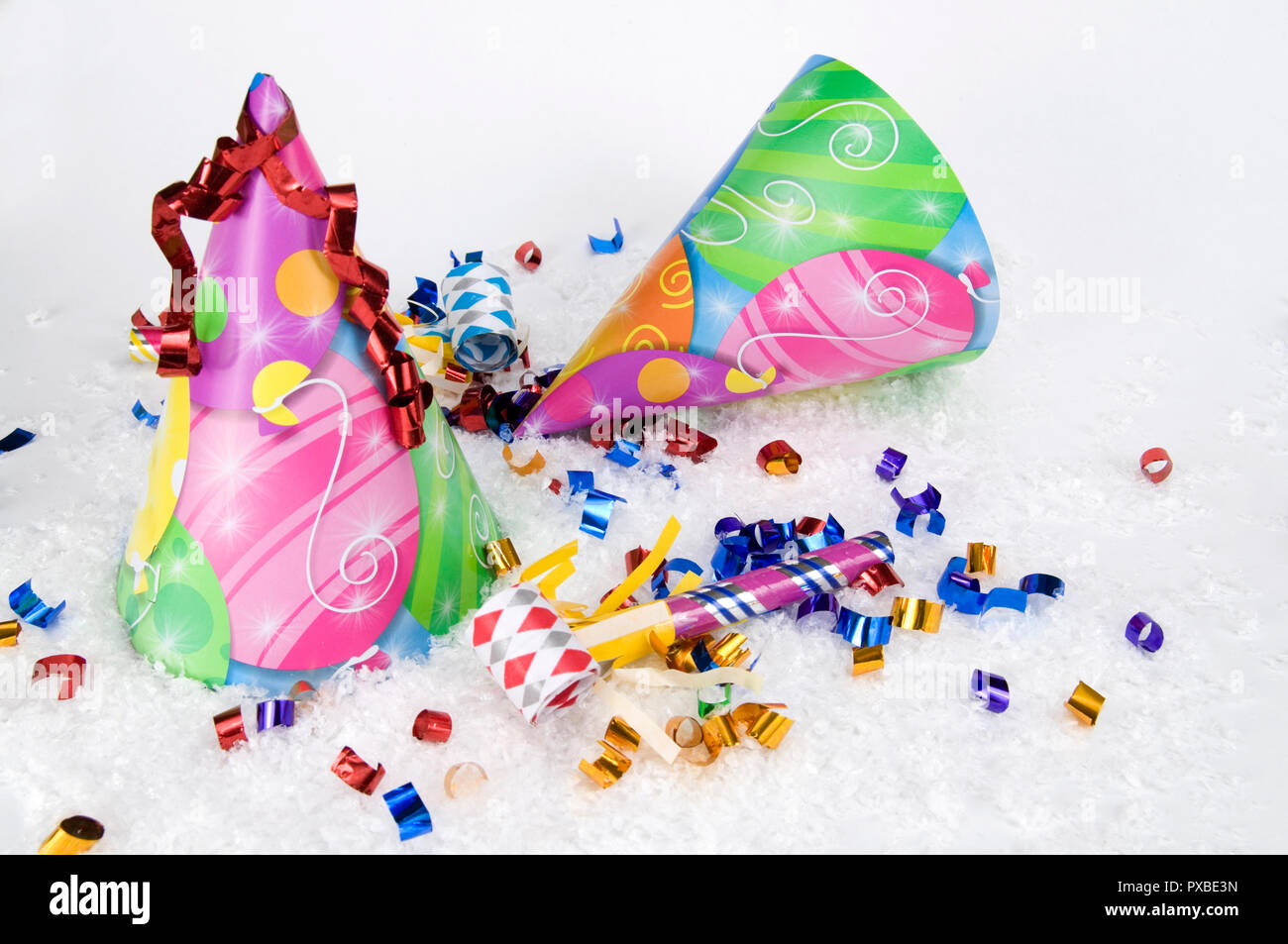 123c48c7f13 Party Hats and Party Whistles on white snow for New year s Eve Stock ...
