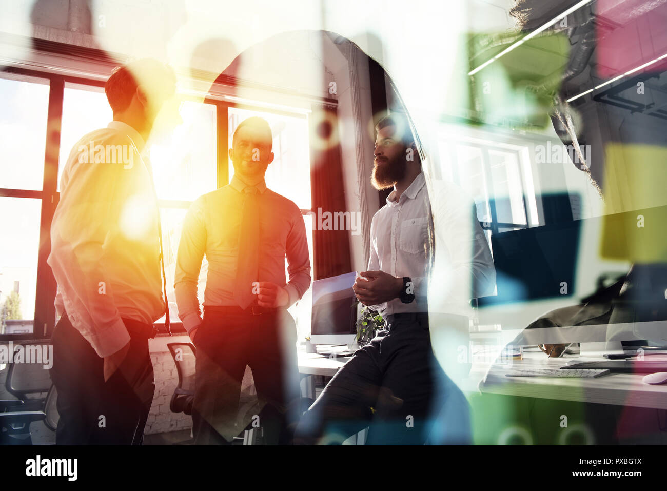 Business people work together in office. Concept of teamwork and partnership. double exposure with light effects - Stock Image