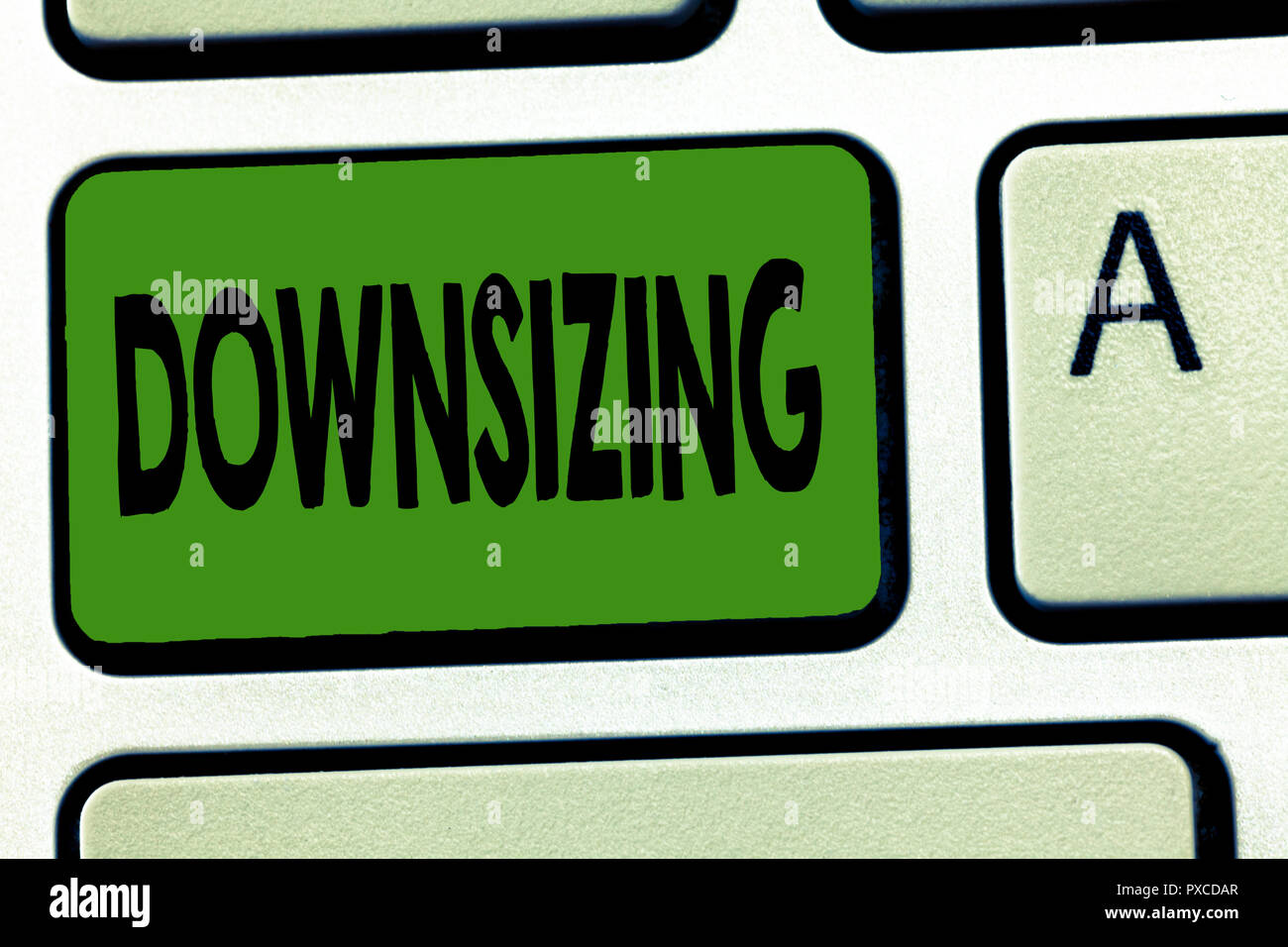 Handwriting text Downsizing. Concept meaning Make a company smaller by shedding staff Expenses reduction. - Stock Image